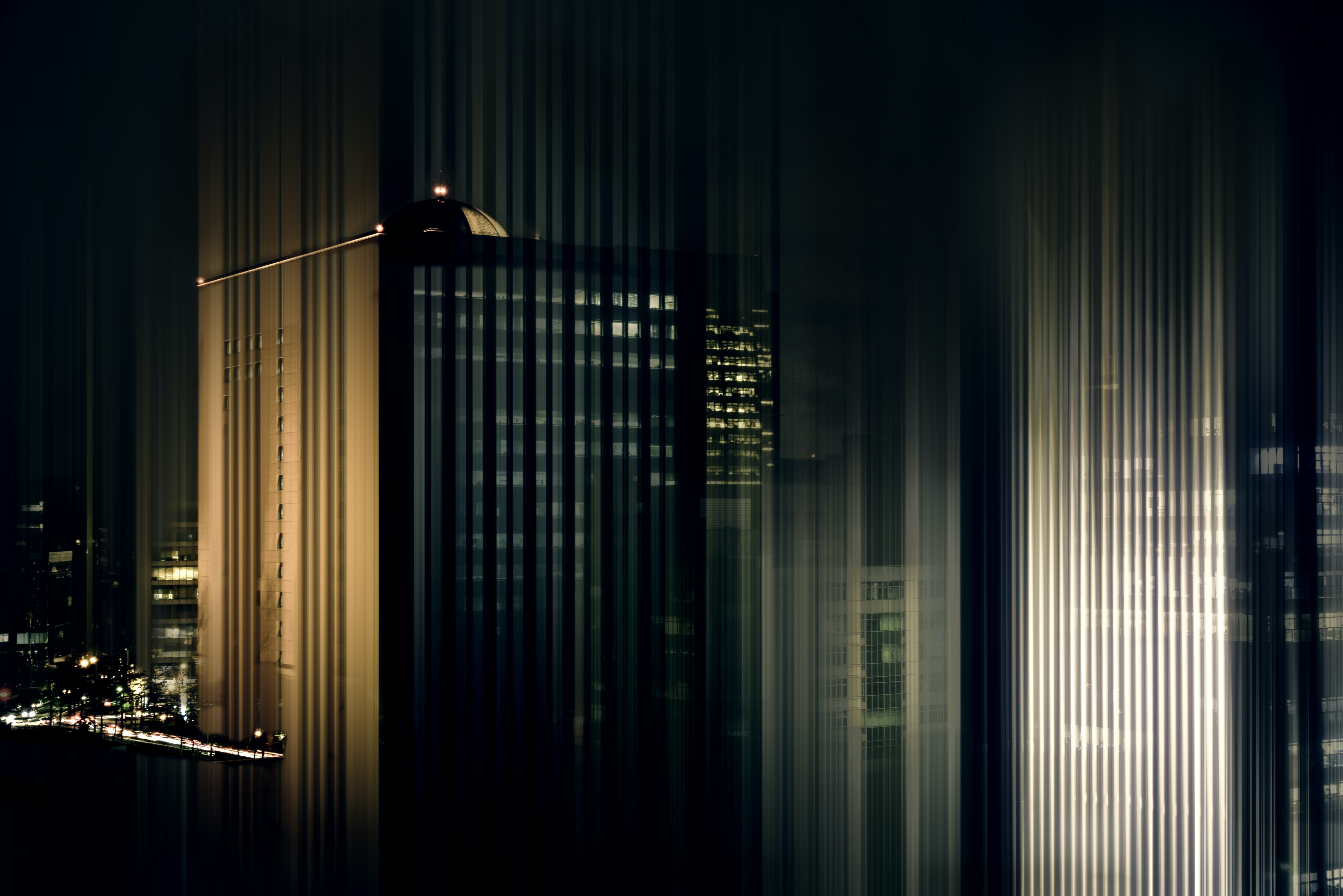 gray high-rise buildings at night time