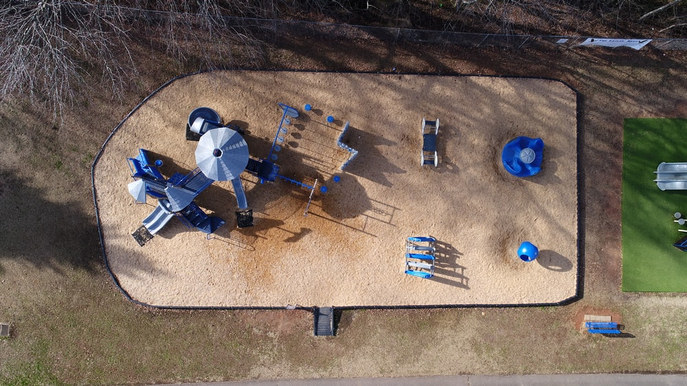 aerial photograph of toddler's park on sand