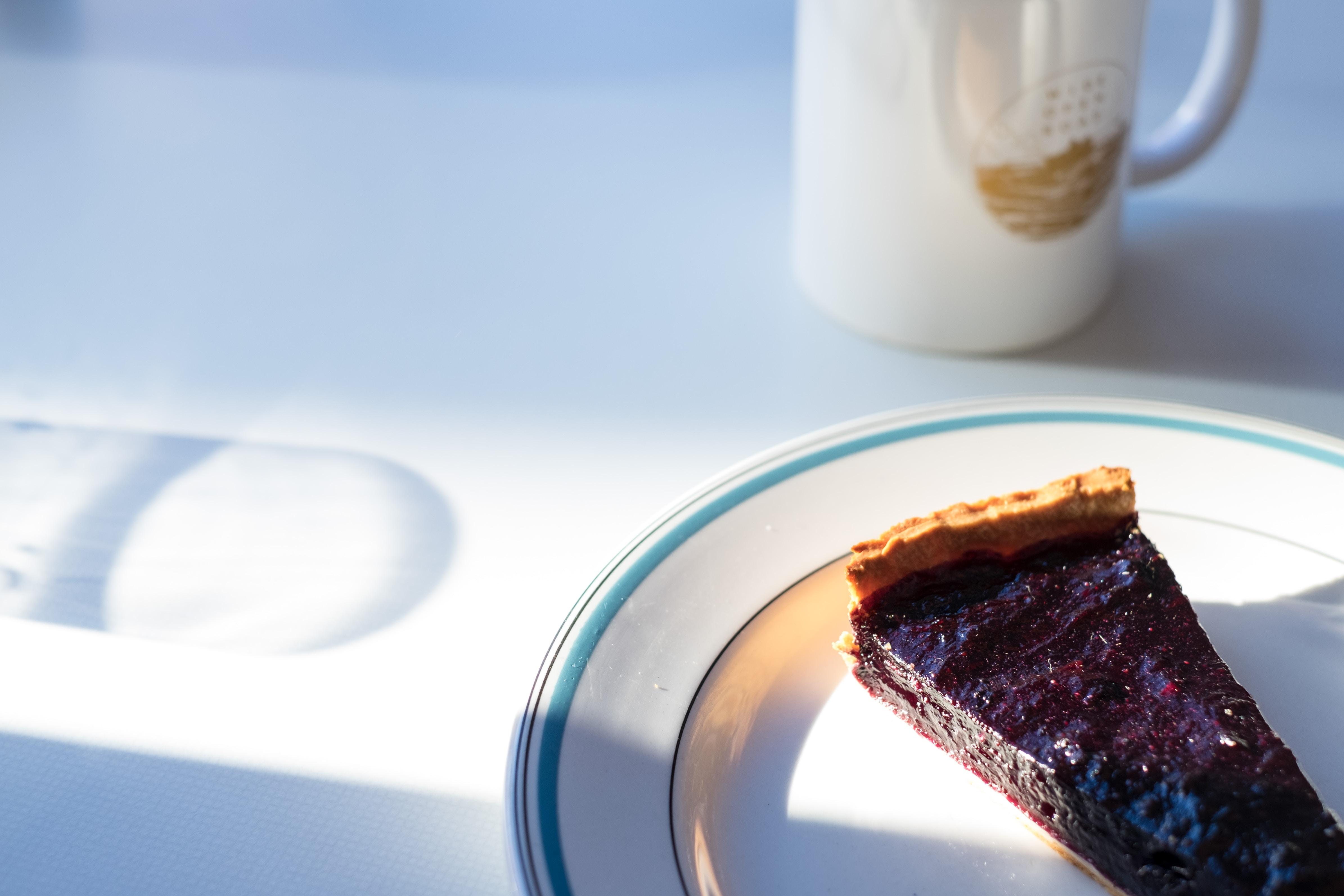 closeup photo of sliced cake on white plate