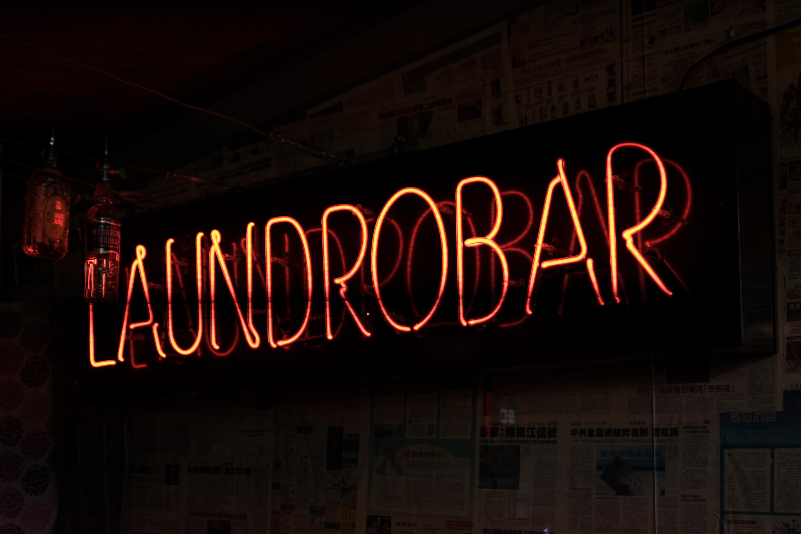 black and brown Laundrobar signage
