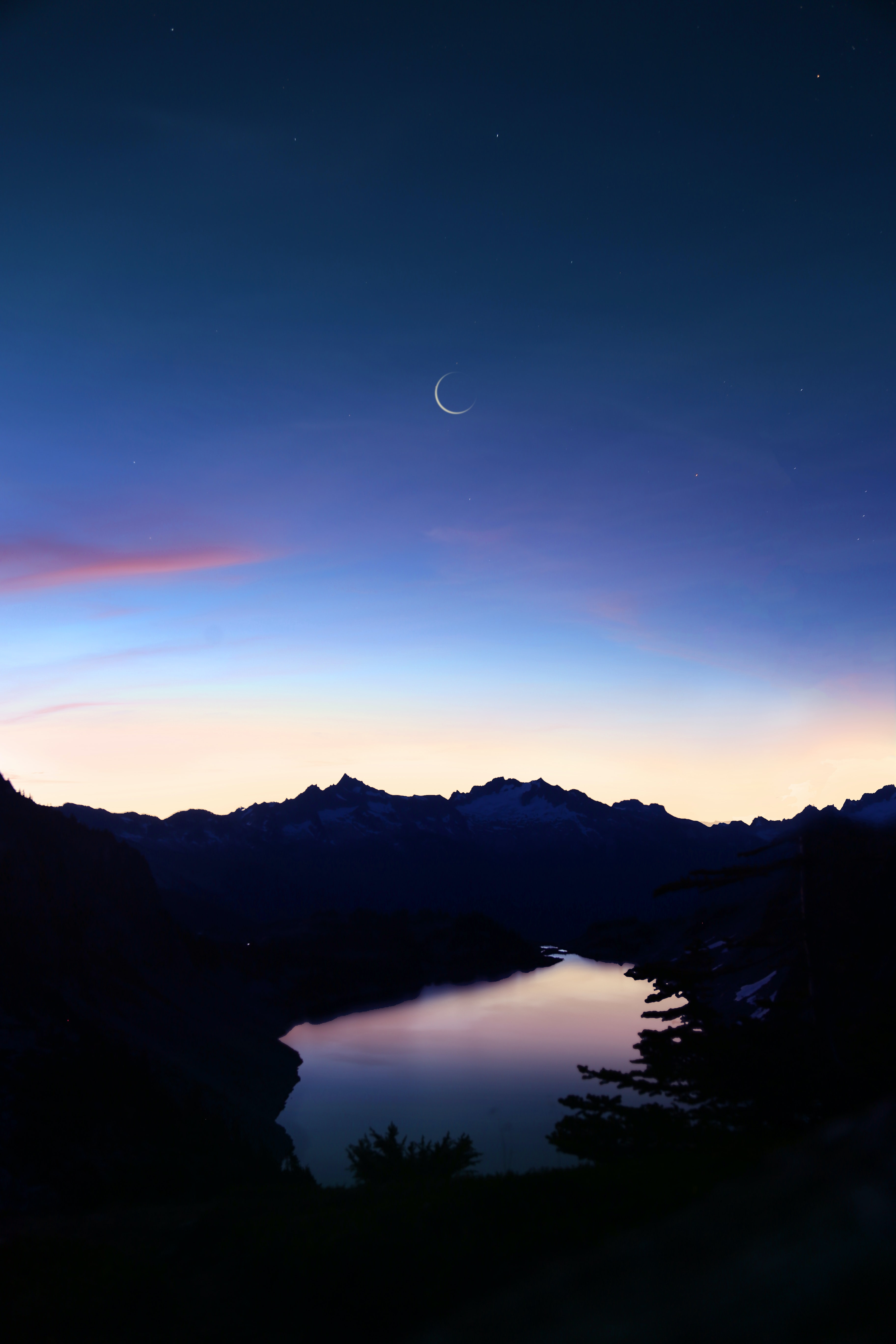 birds eye-view of lake under crescent moon