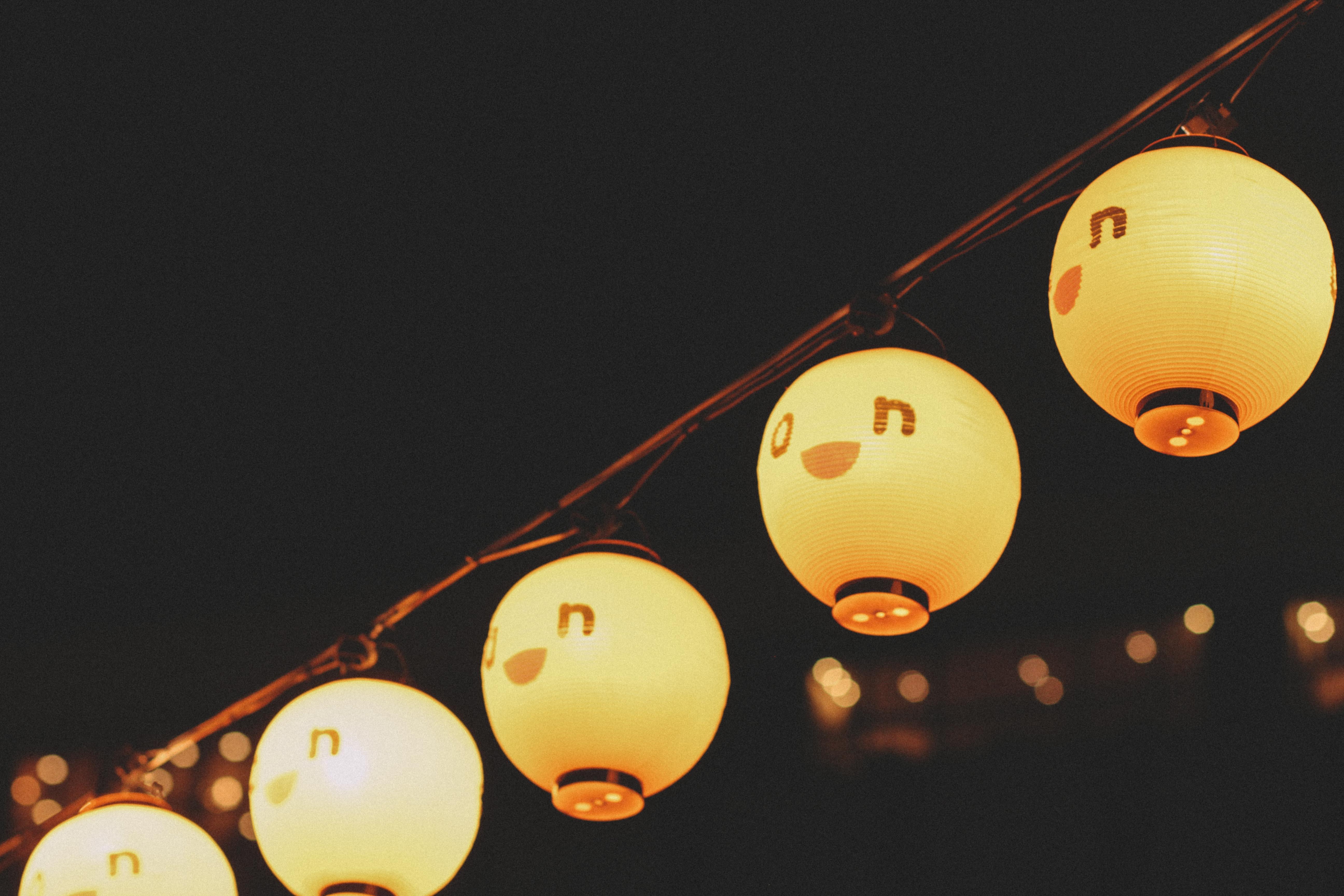 yellow lantern turned on at nighttime