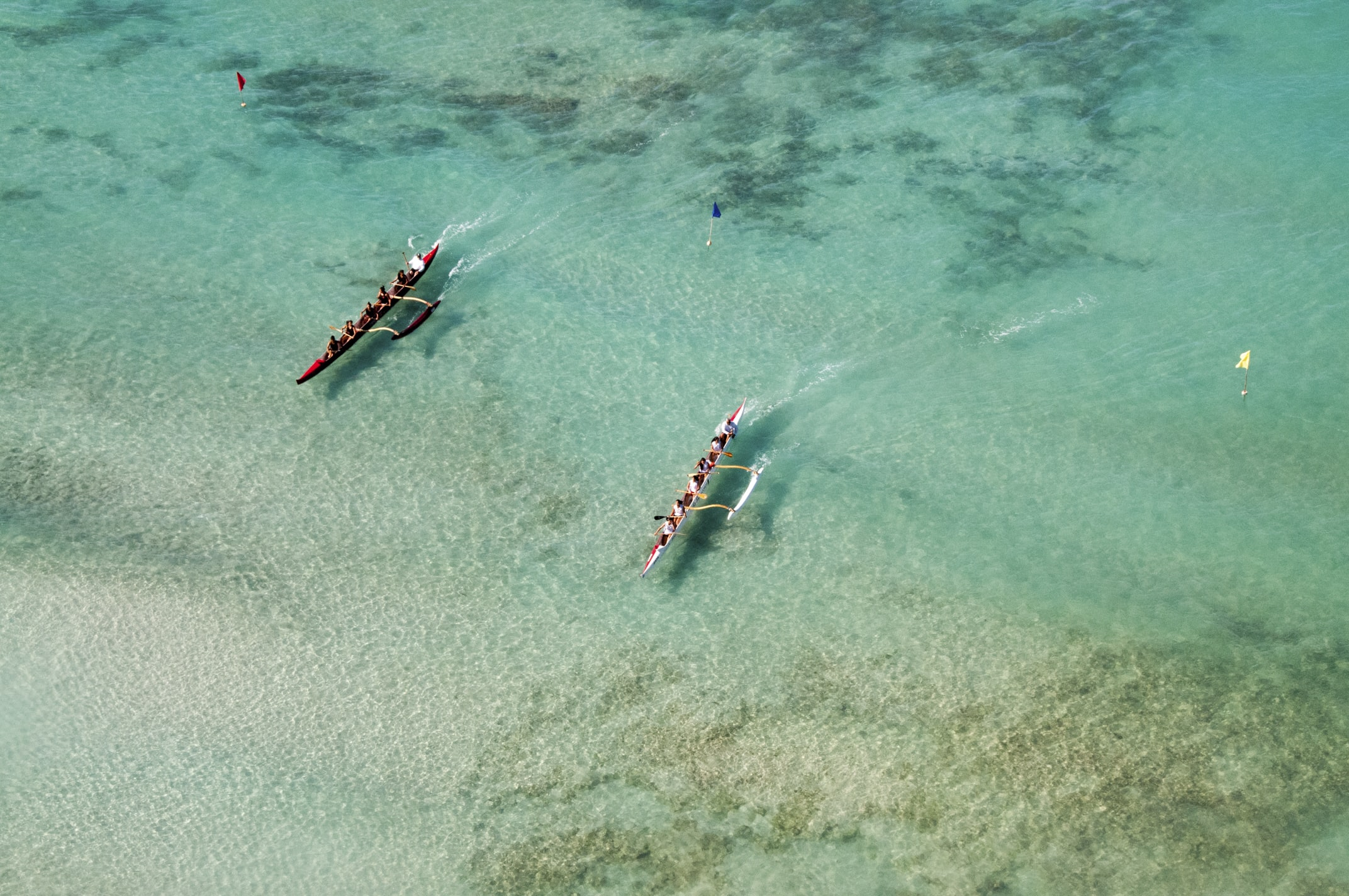 bird's eye view of two boats on body of water