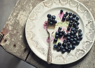 black fruits and fork in plate
