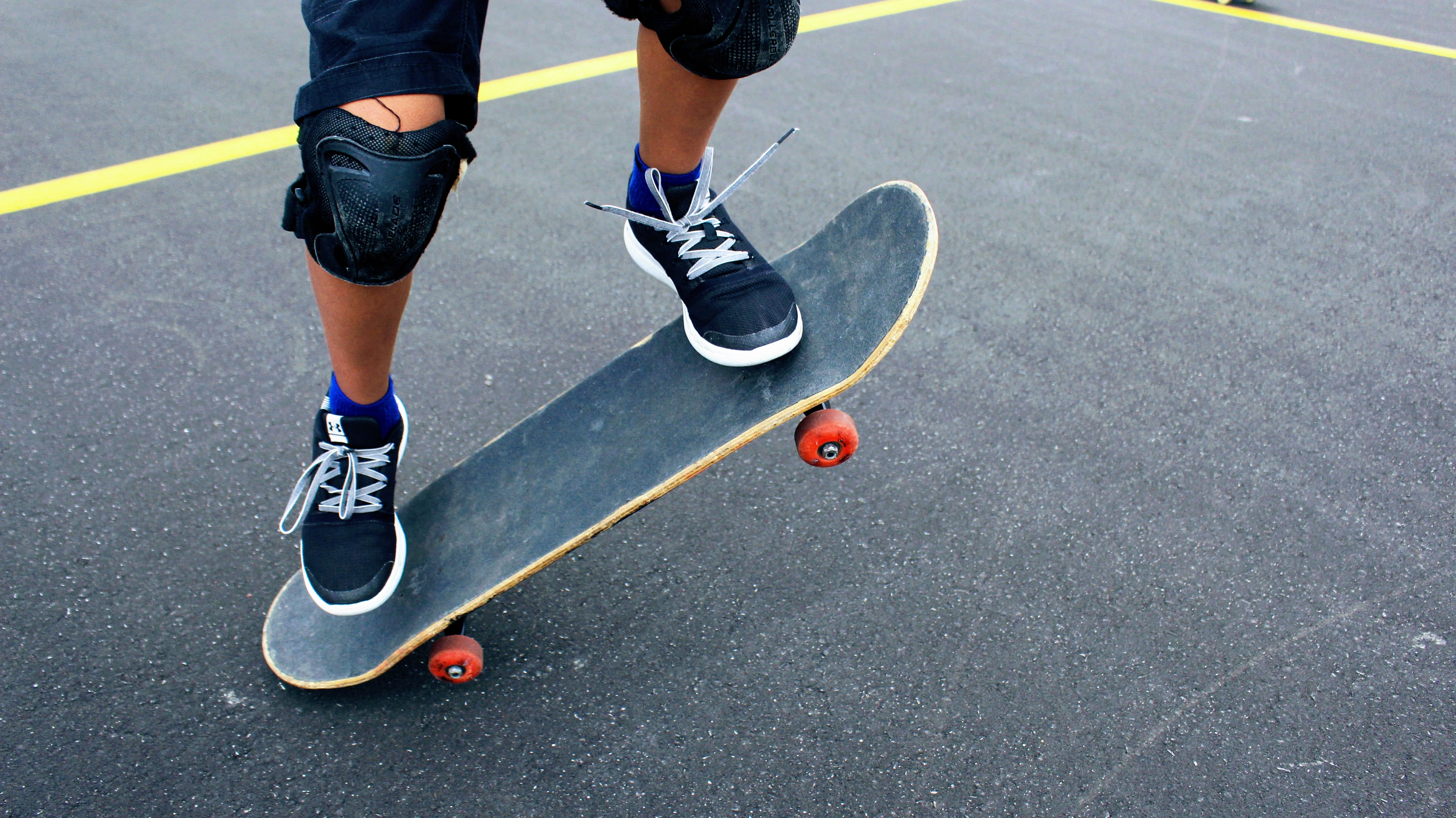 person on skateboard at daytime