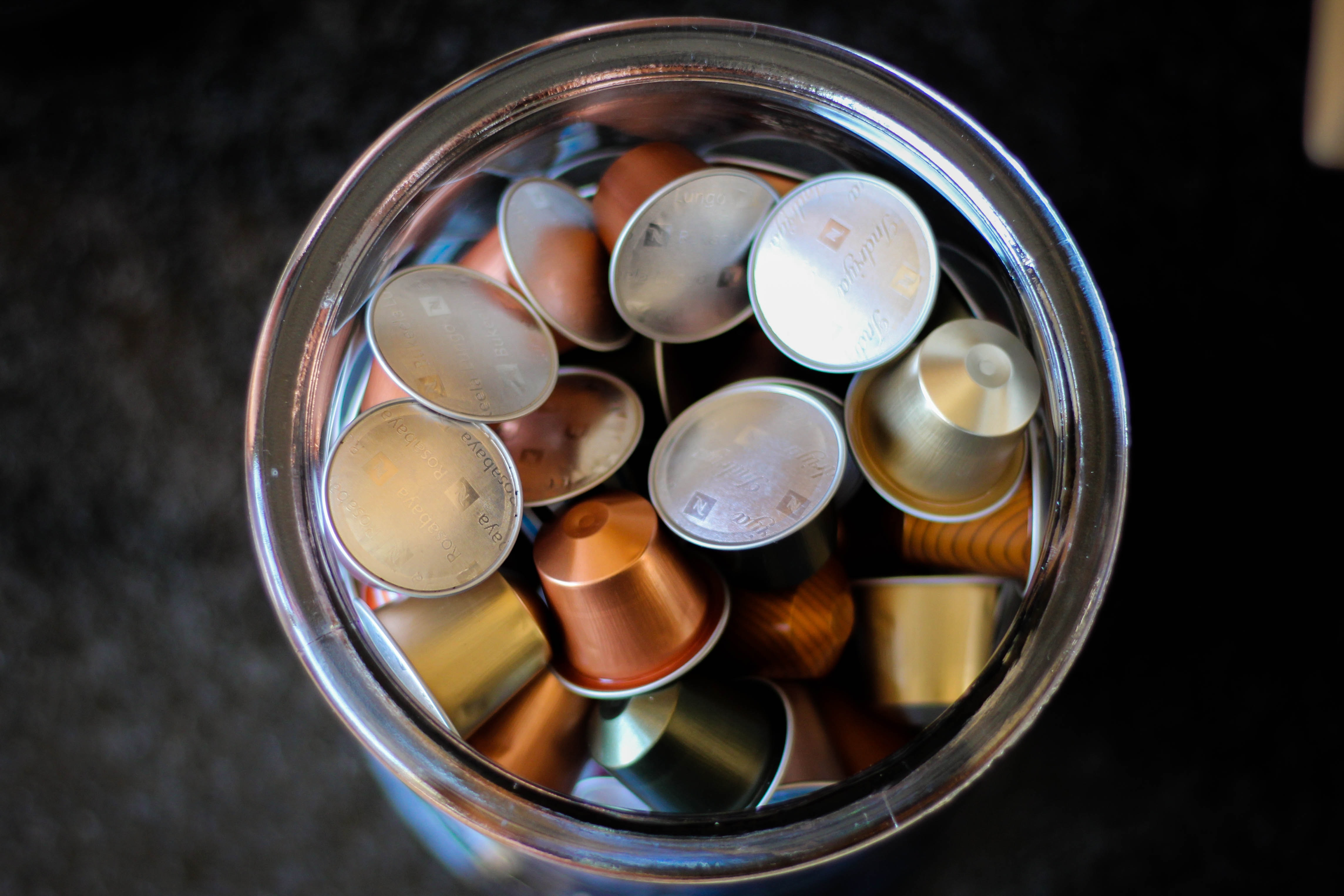 assorted-color metal timble lot in clear glass jar