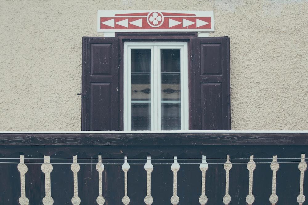opened brown wooden door at daytime