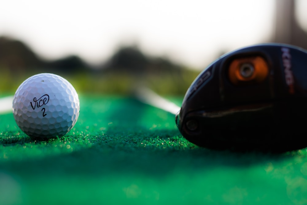 shallow focus photography of white golf ball