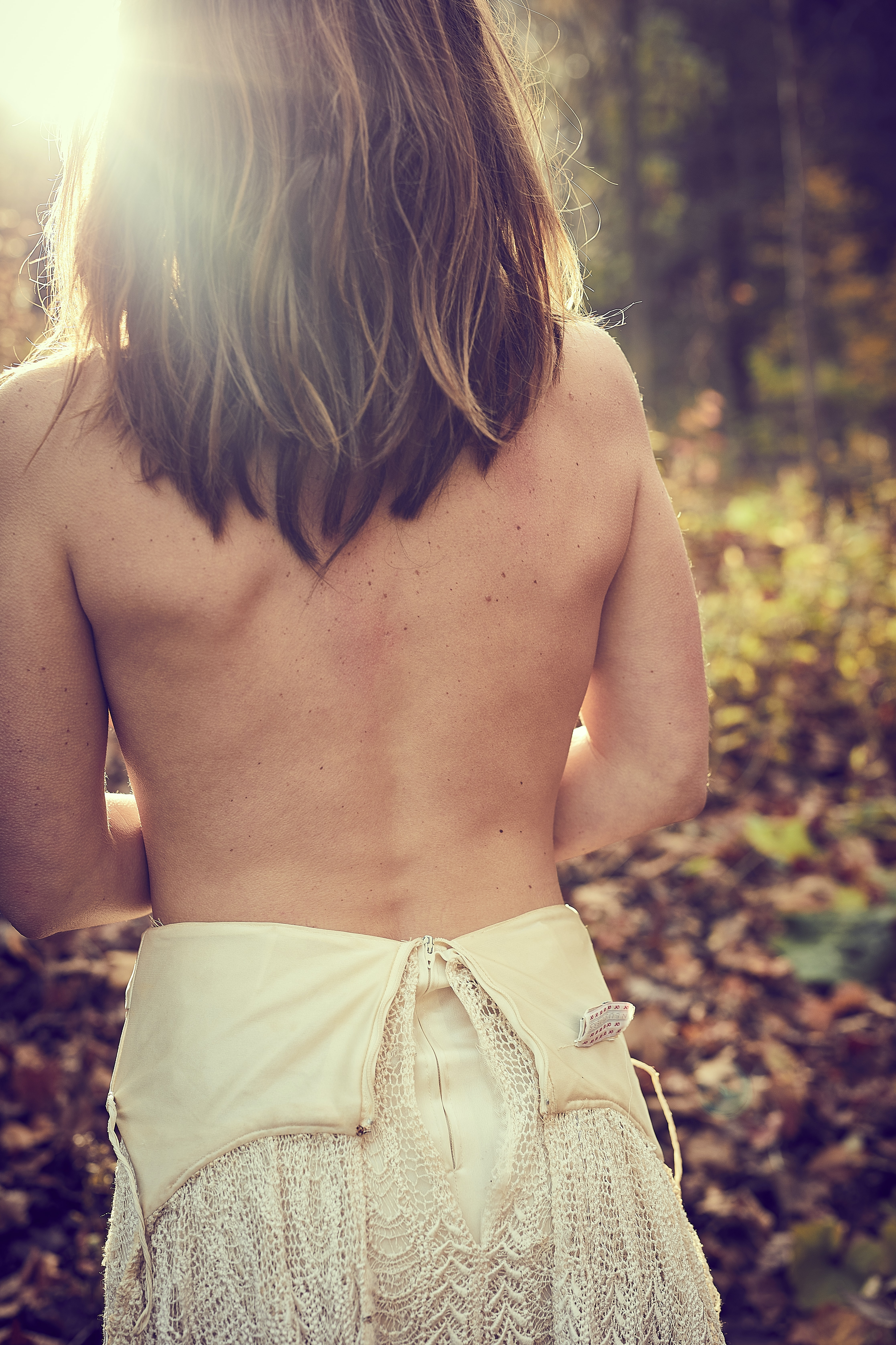 woman top less near plants during daytime