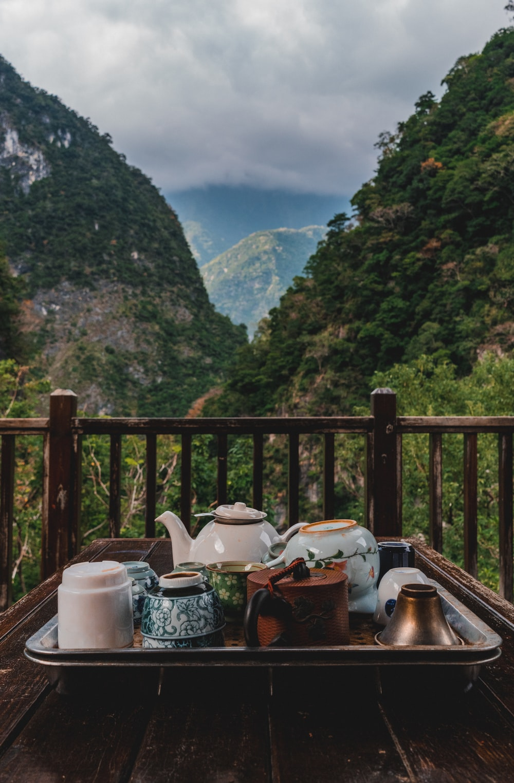 white teapot on stainless steel tray