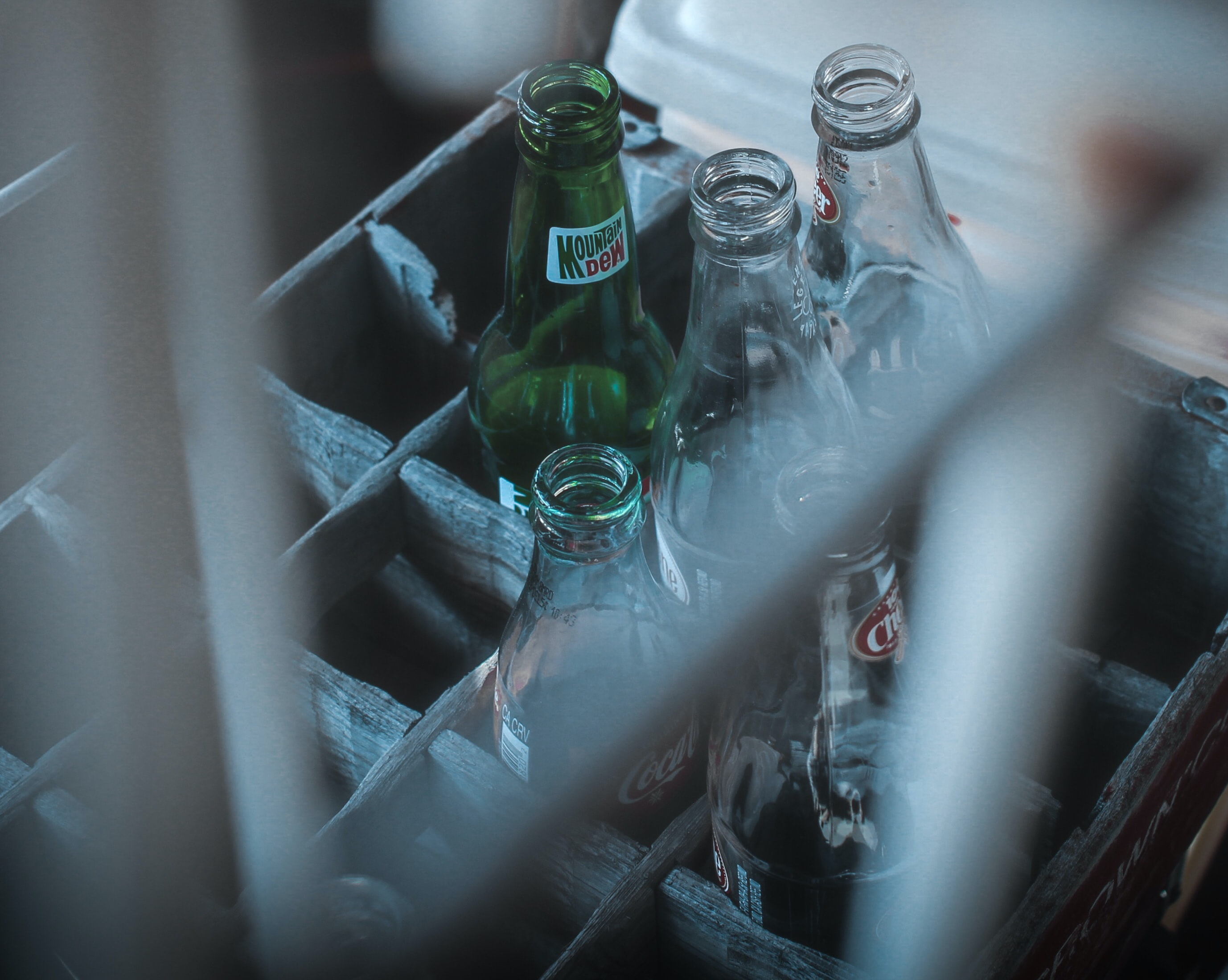photo of glass soda bottles on crate