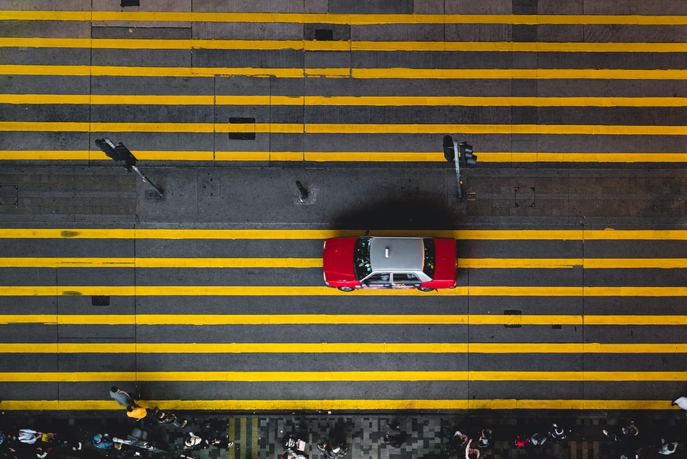 aerial photograph of gray and red car on street