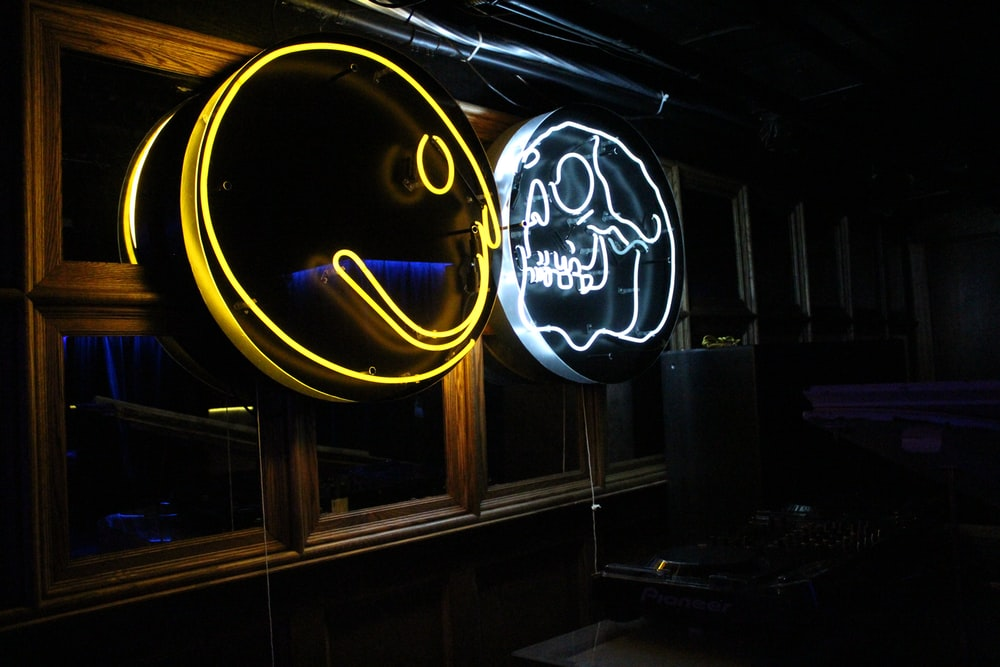 two yellow and gray skull LED signages
