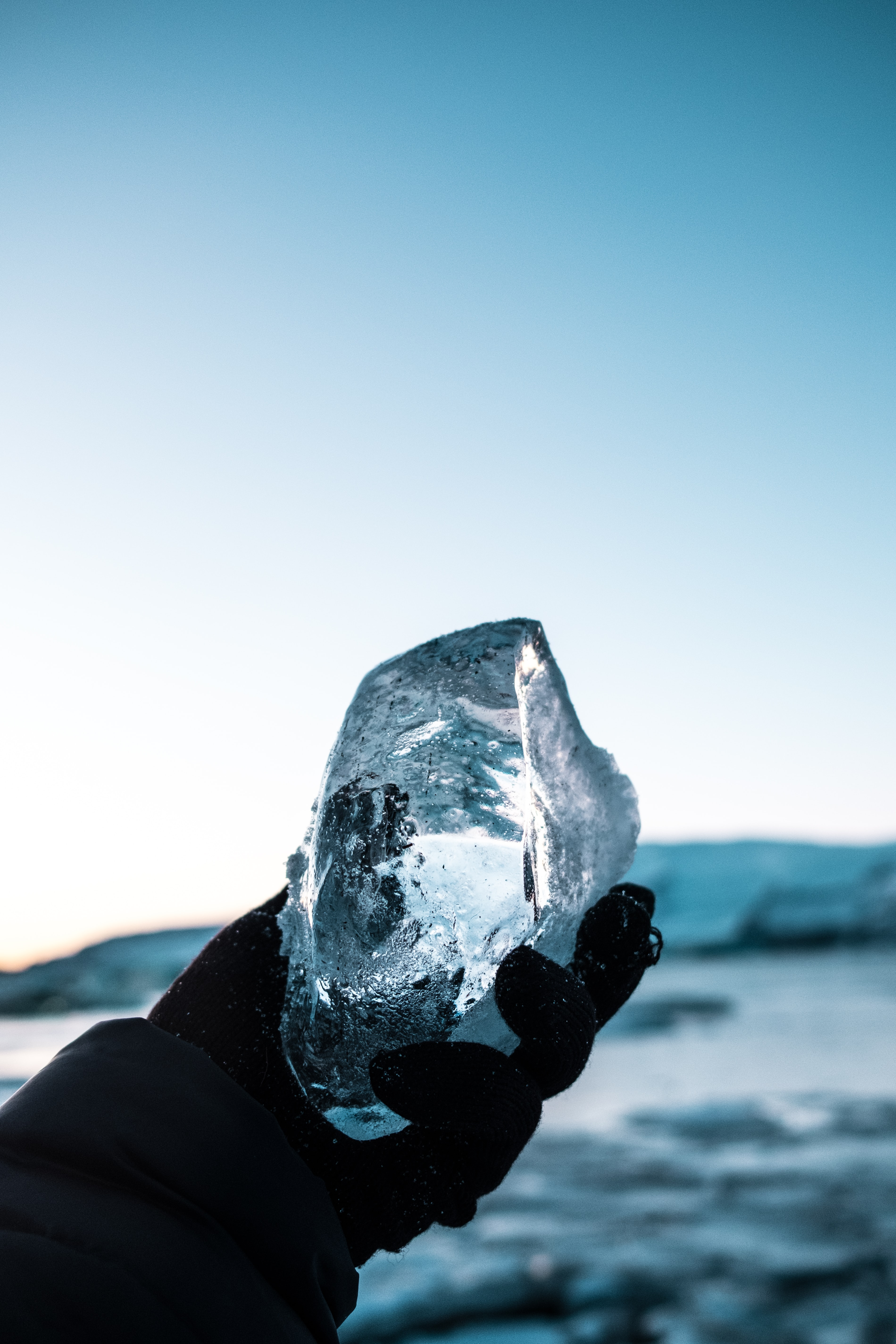 person holding block of ice