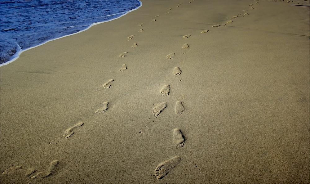 foot prints on brown sands