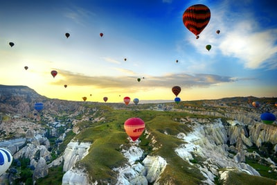assorted color hot air balloons during day time hot air balloon teams background