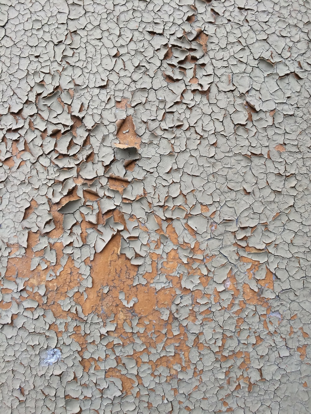 cracked gray wall paint