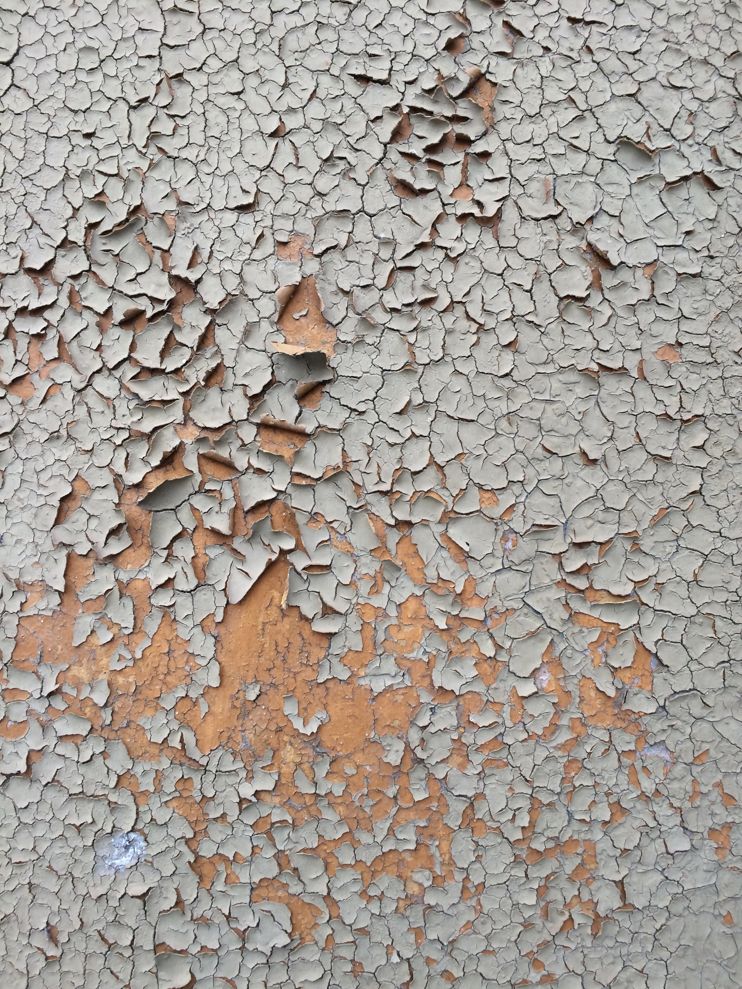 cracked gray wall paint