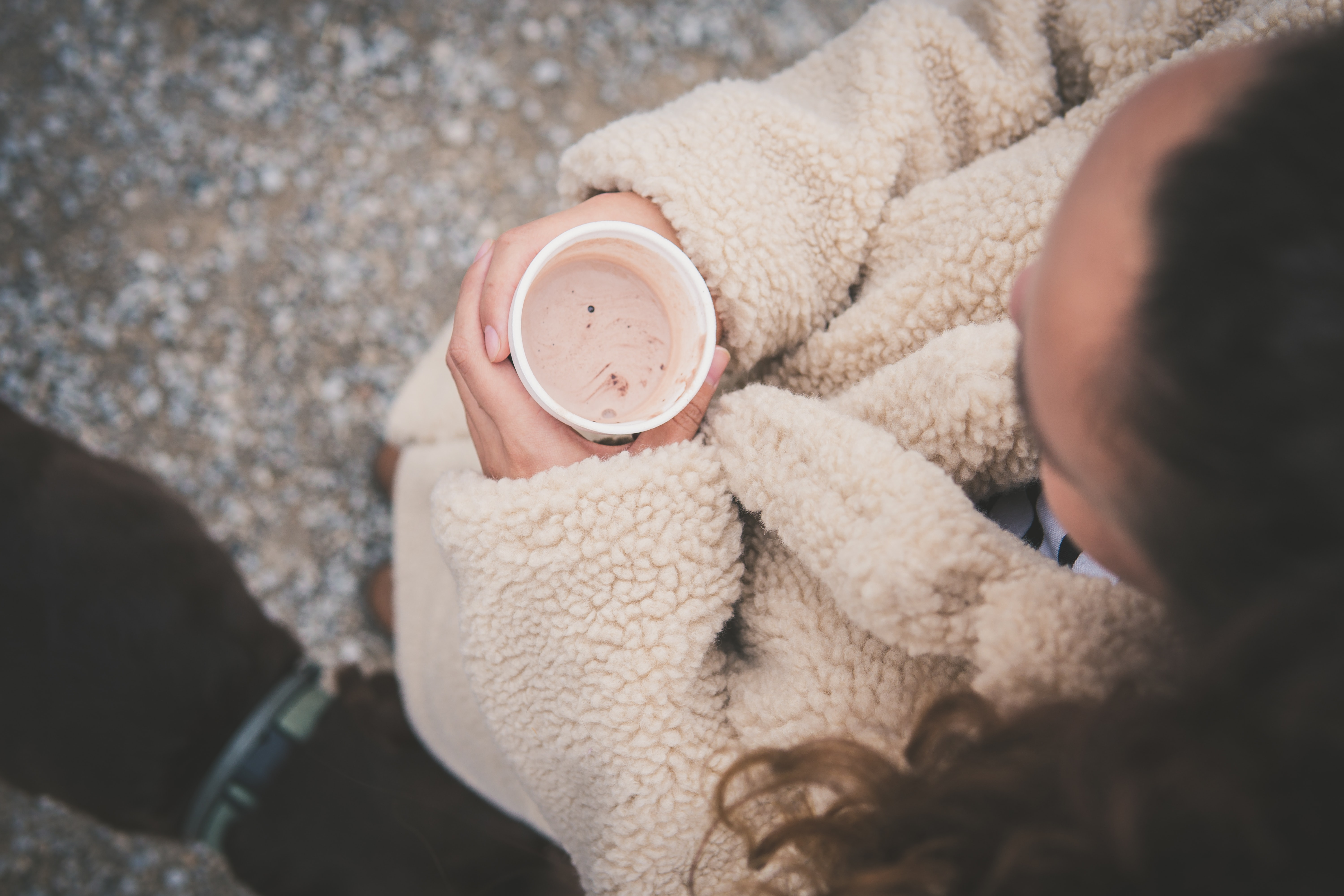 woman holding disposable cup