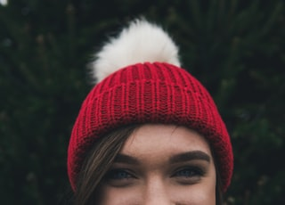 woman wearing red bobble hat