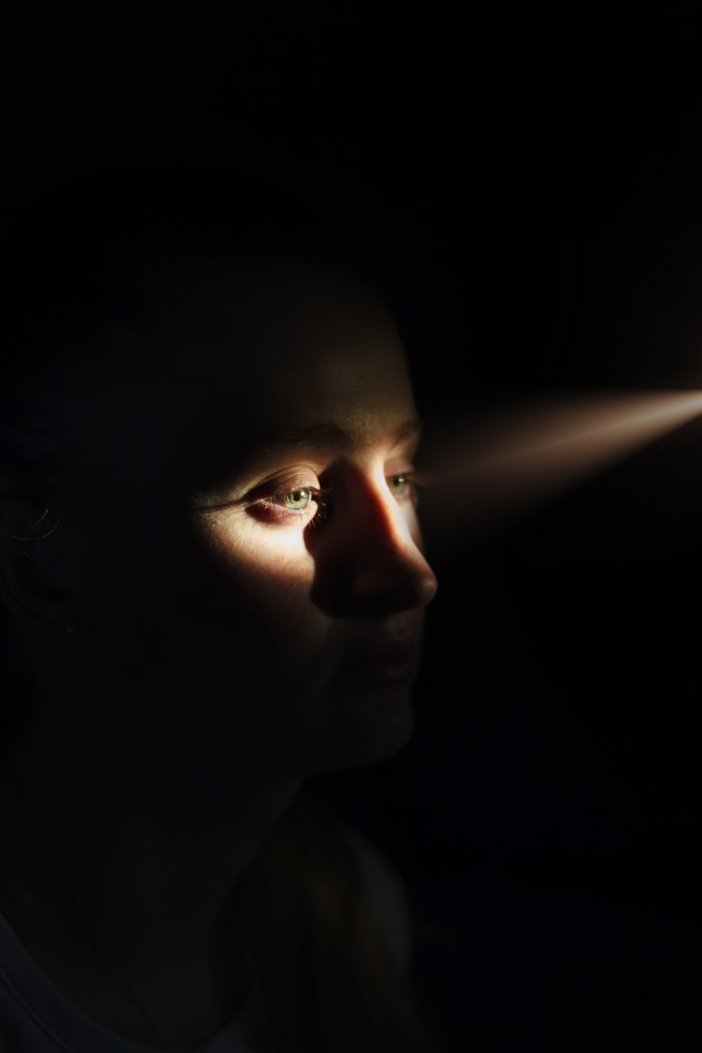 woman's face with sunlight on eyes