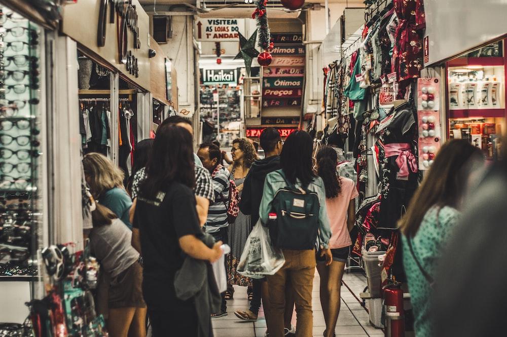 people walking flea market