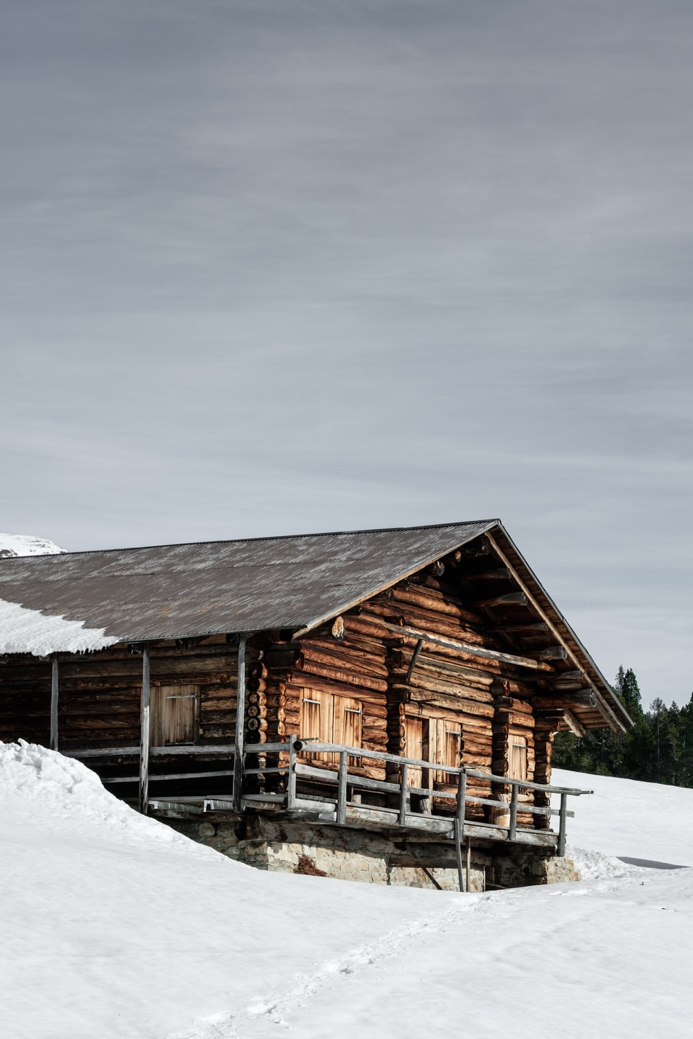 brown shack surrounded snow