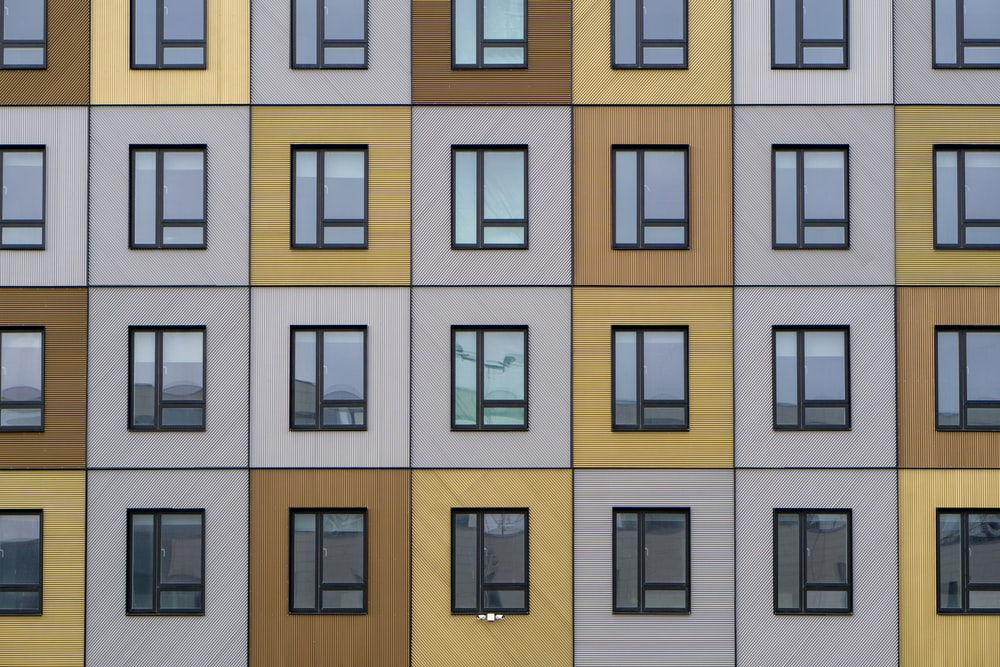 white and beige building windows