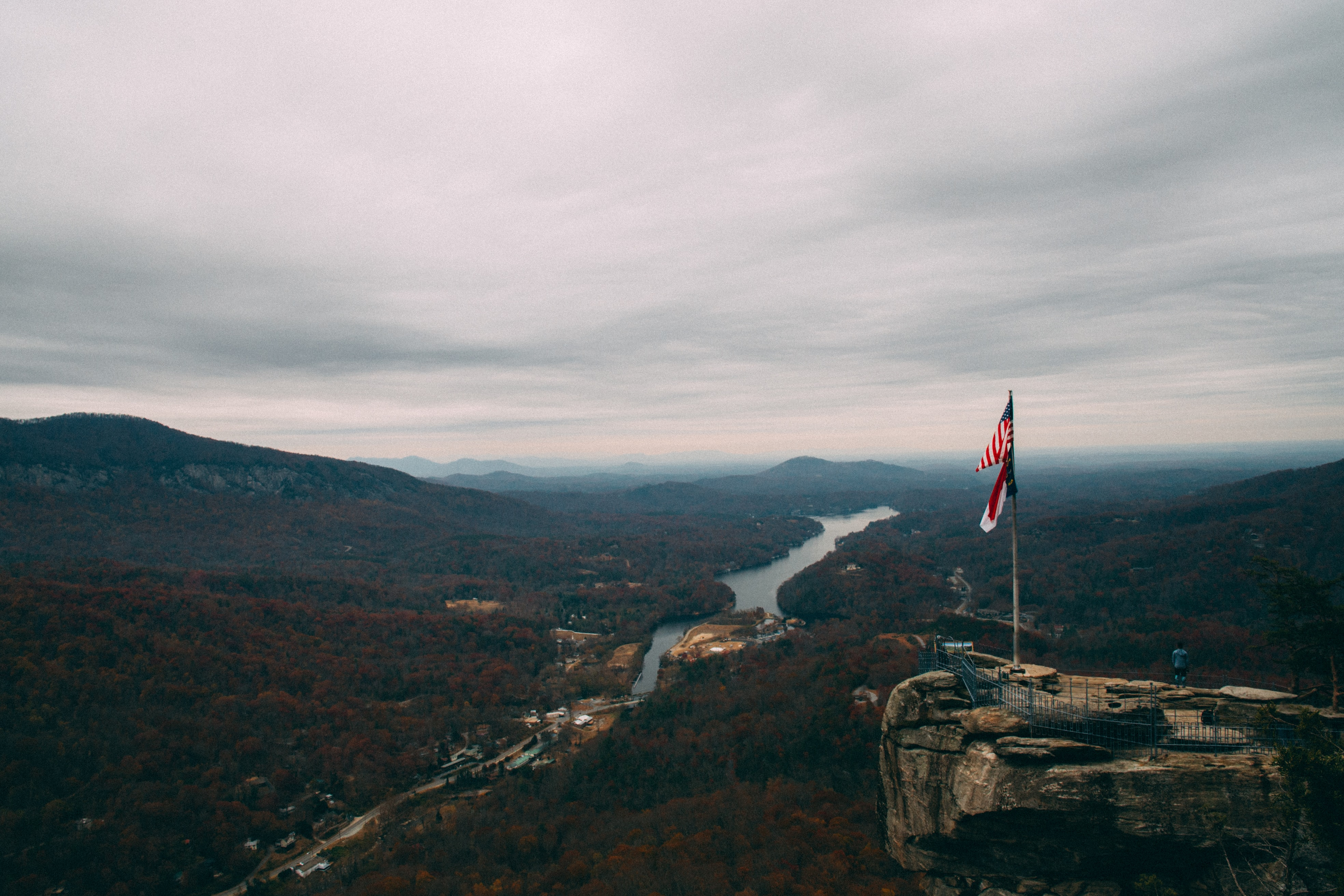aerial photography of U.S. flag on cliff