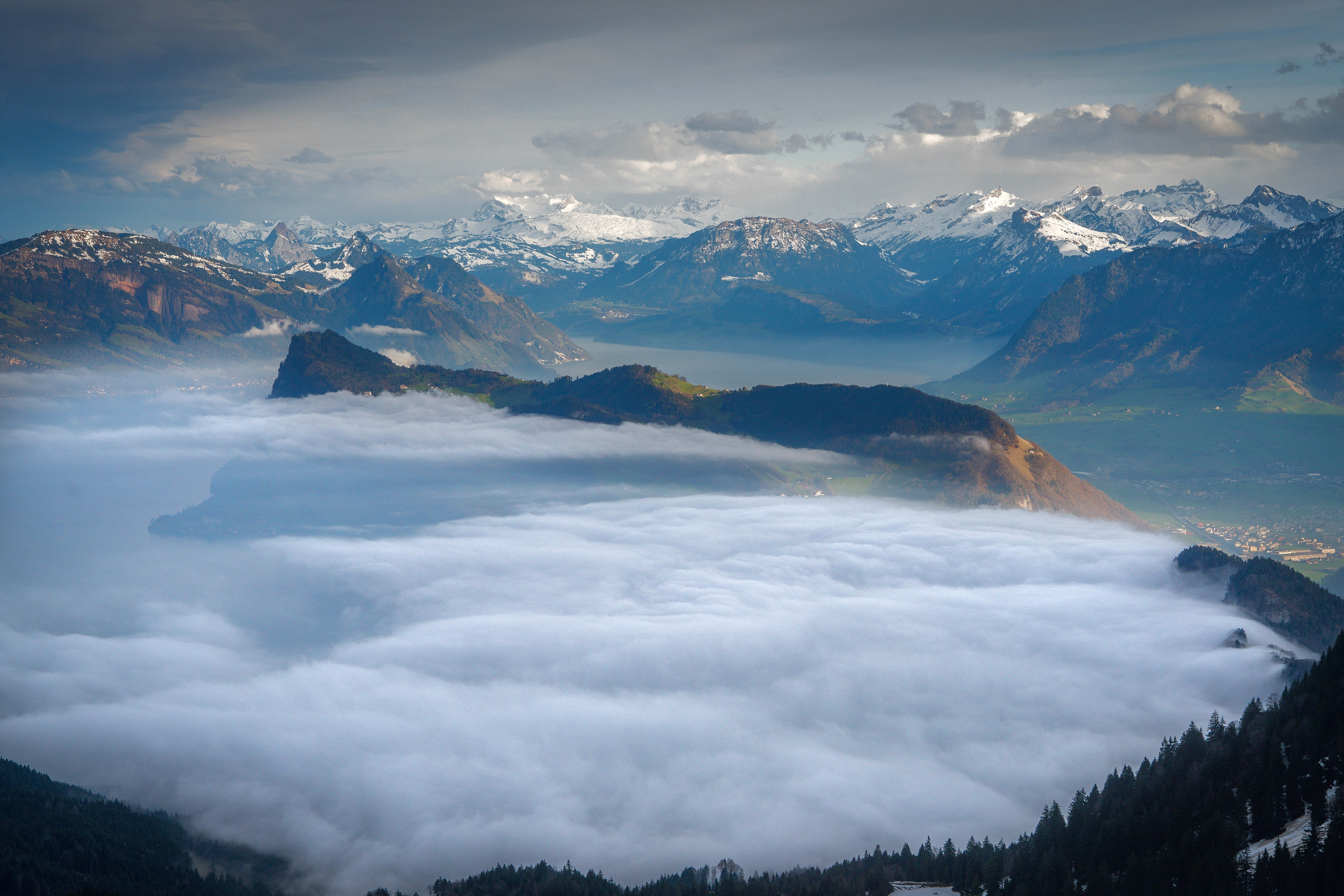 bird's eye view of mountain covered with clouds