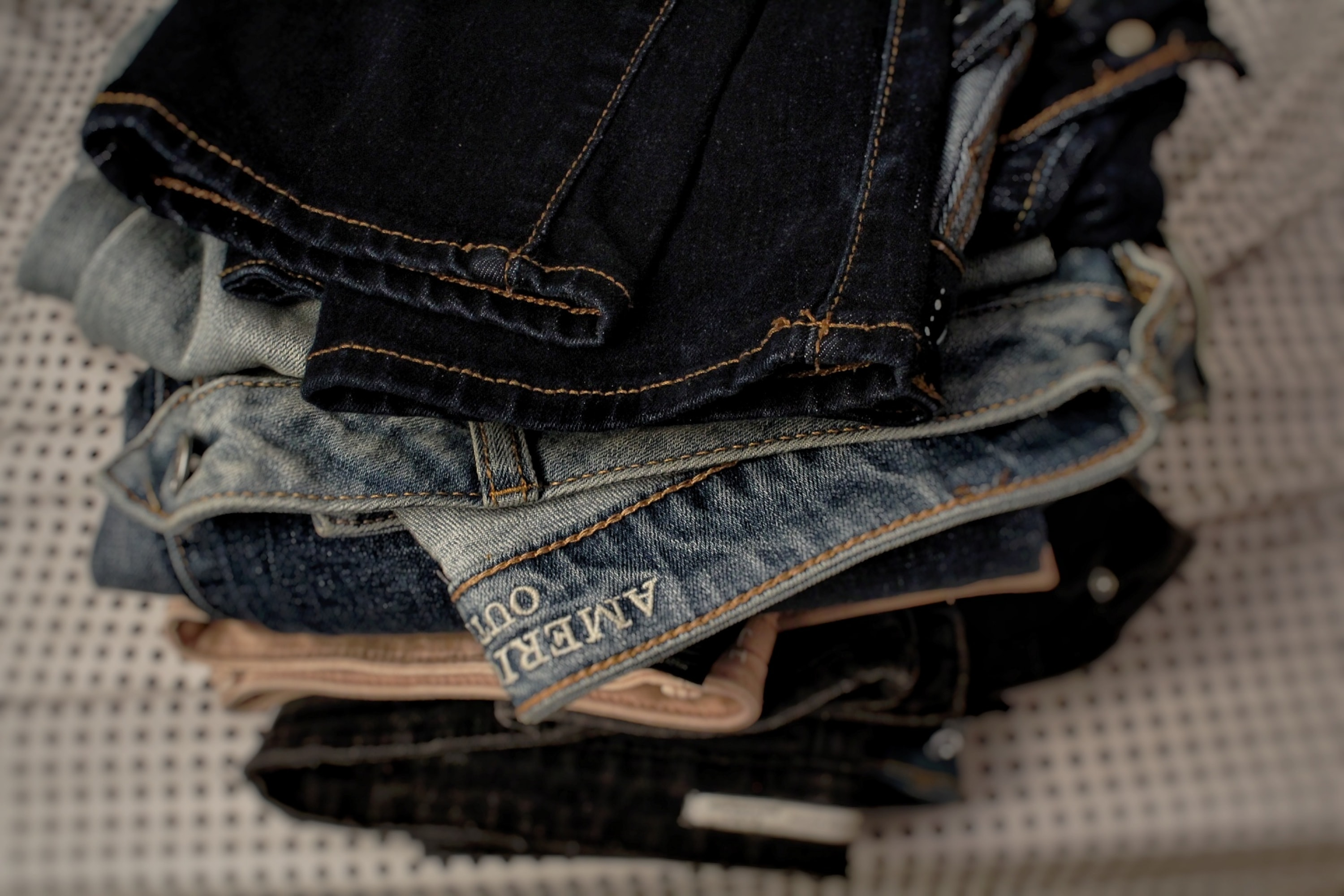 photo of folded denim bottoms