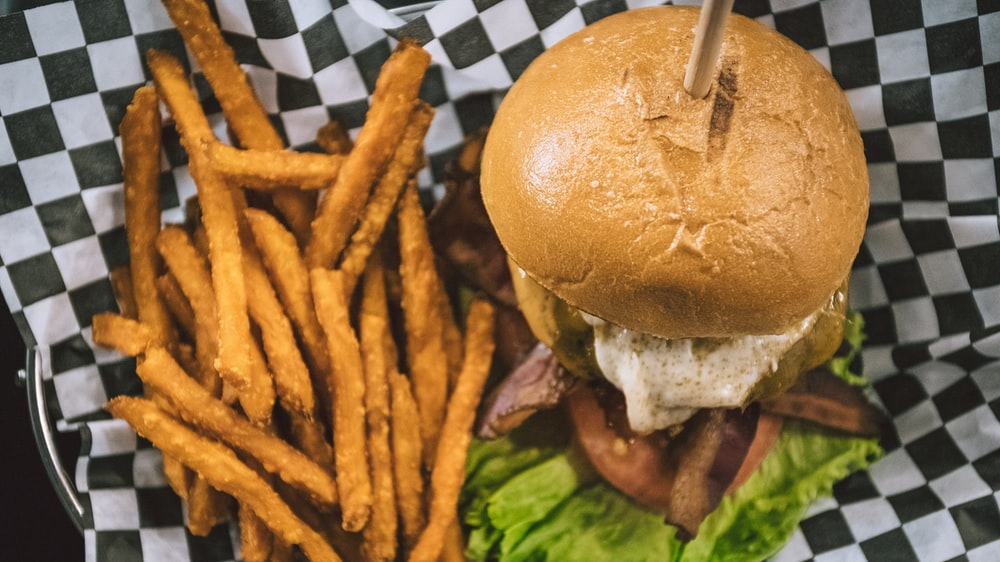 burger and fries on basket