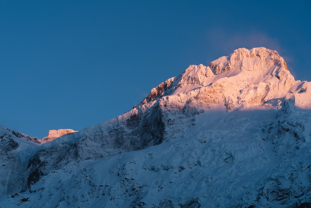 worms eye view photography of snowy mountain