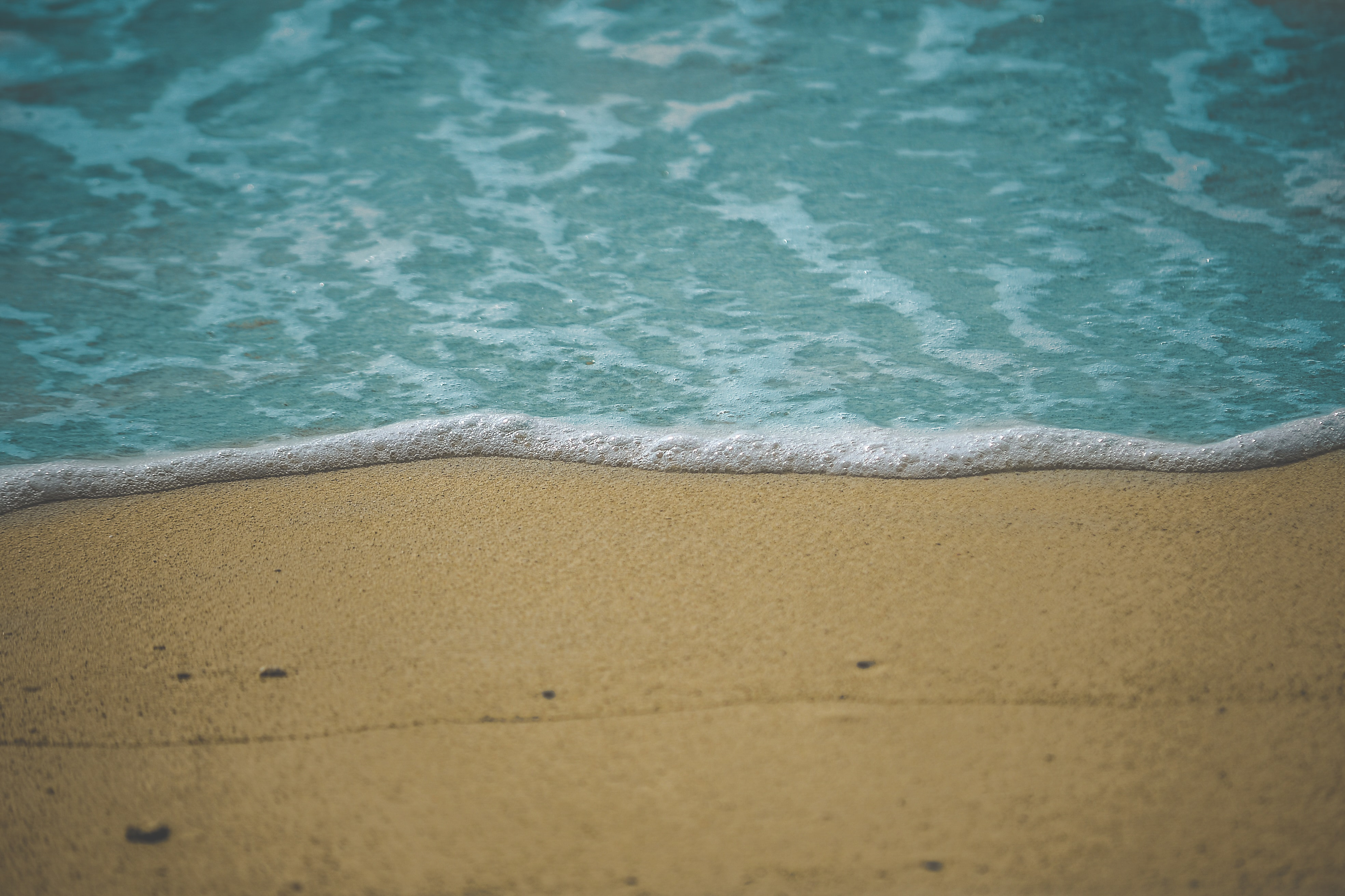 photo of sea water on shore