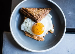 baked sandwich and fried egg in bowl
