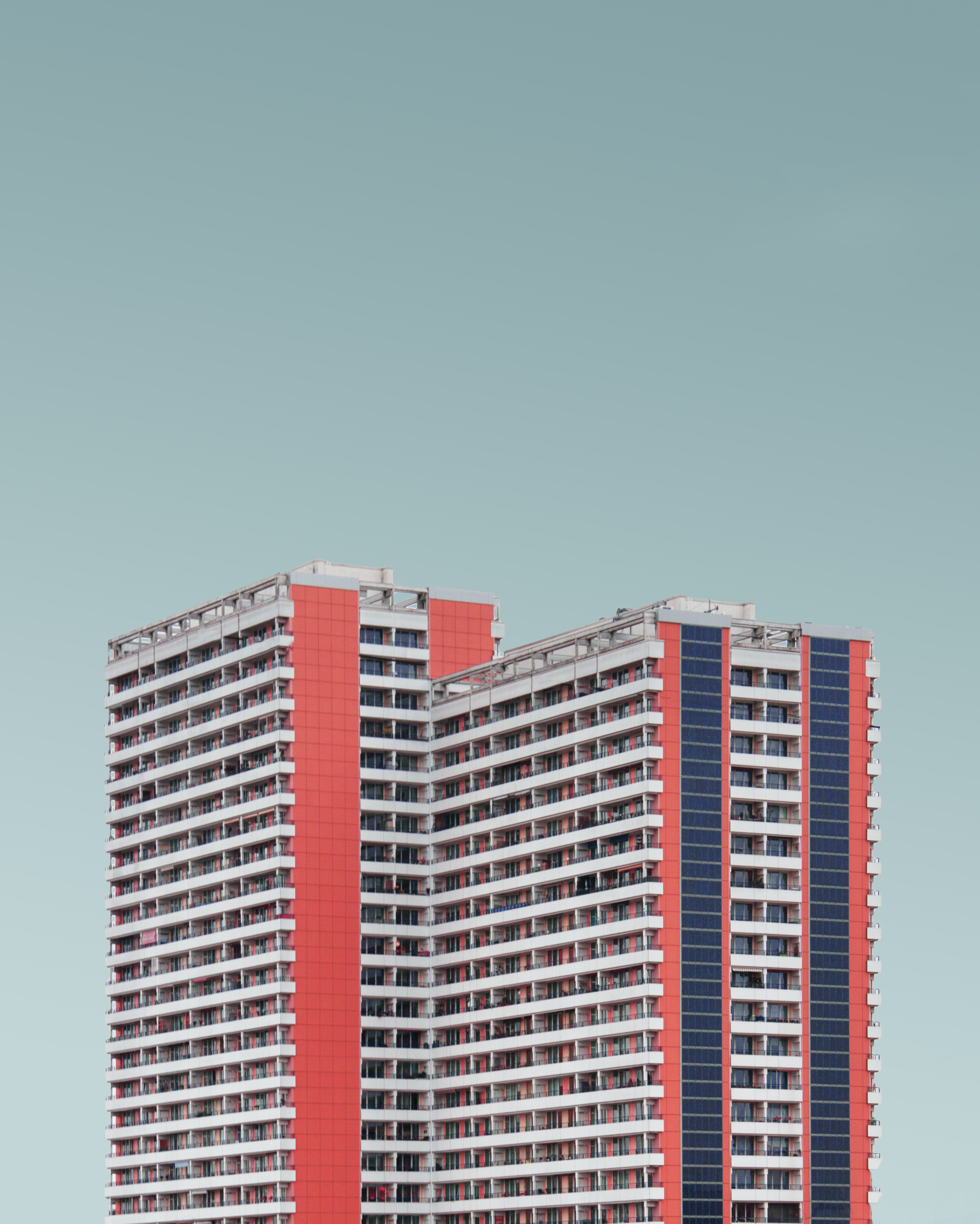 red and white high rise building under blue sky