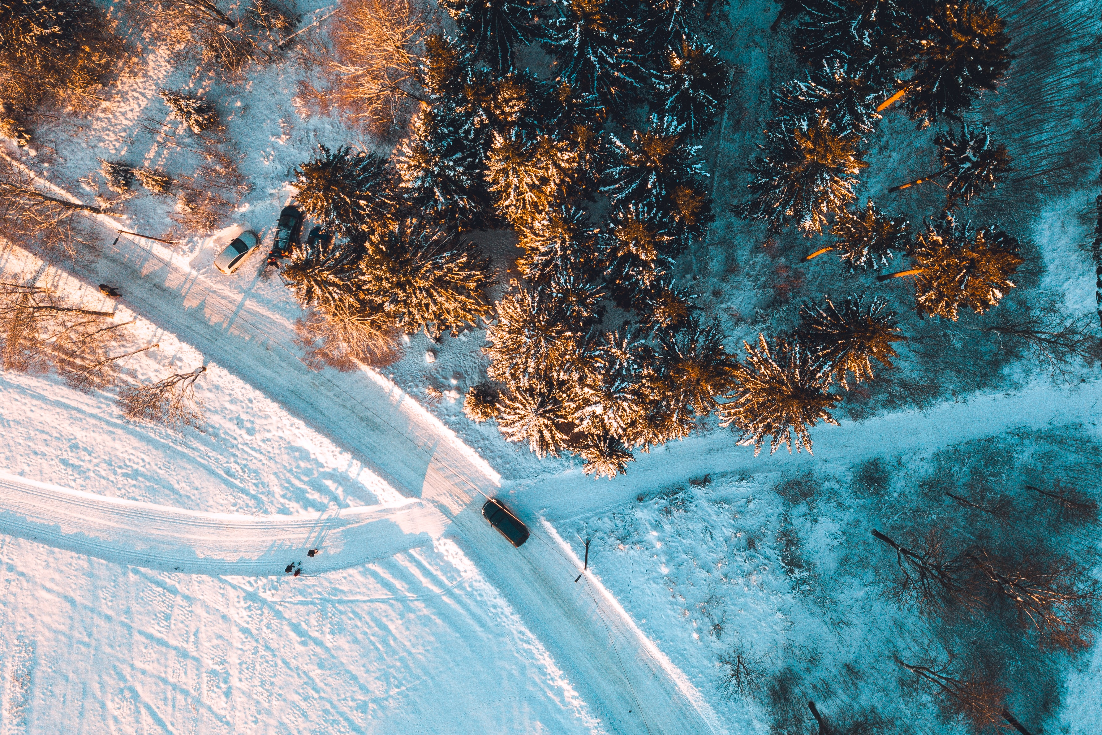 aerial view of snow covered forest and road