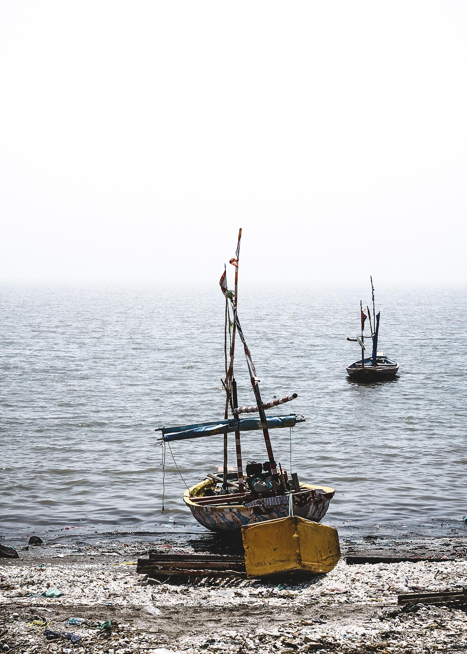 brown and gray sailboat near shore