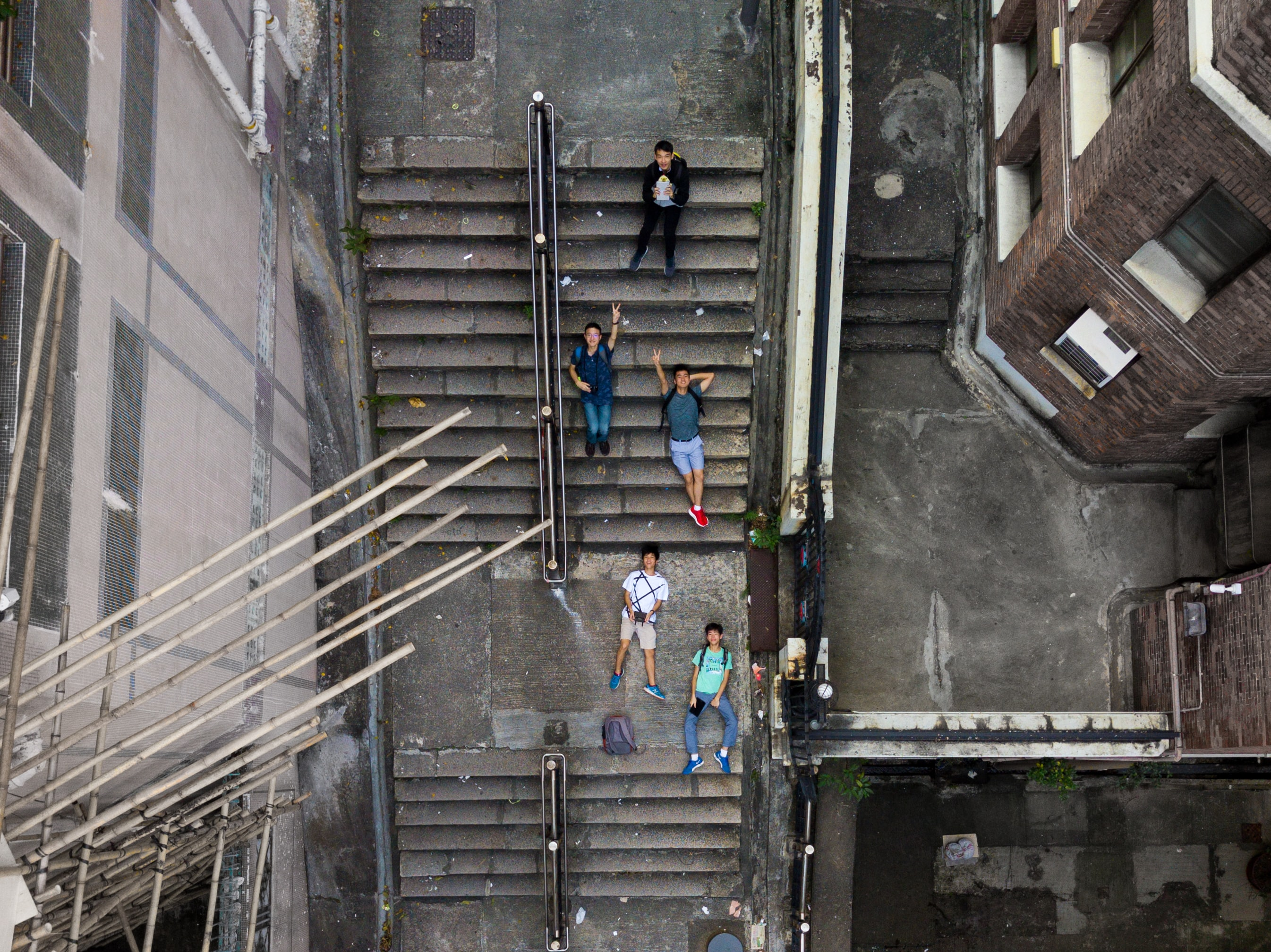 aerial photography of five person's lying on sair
