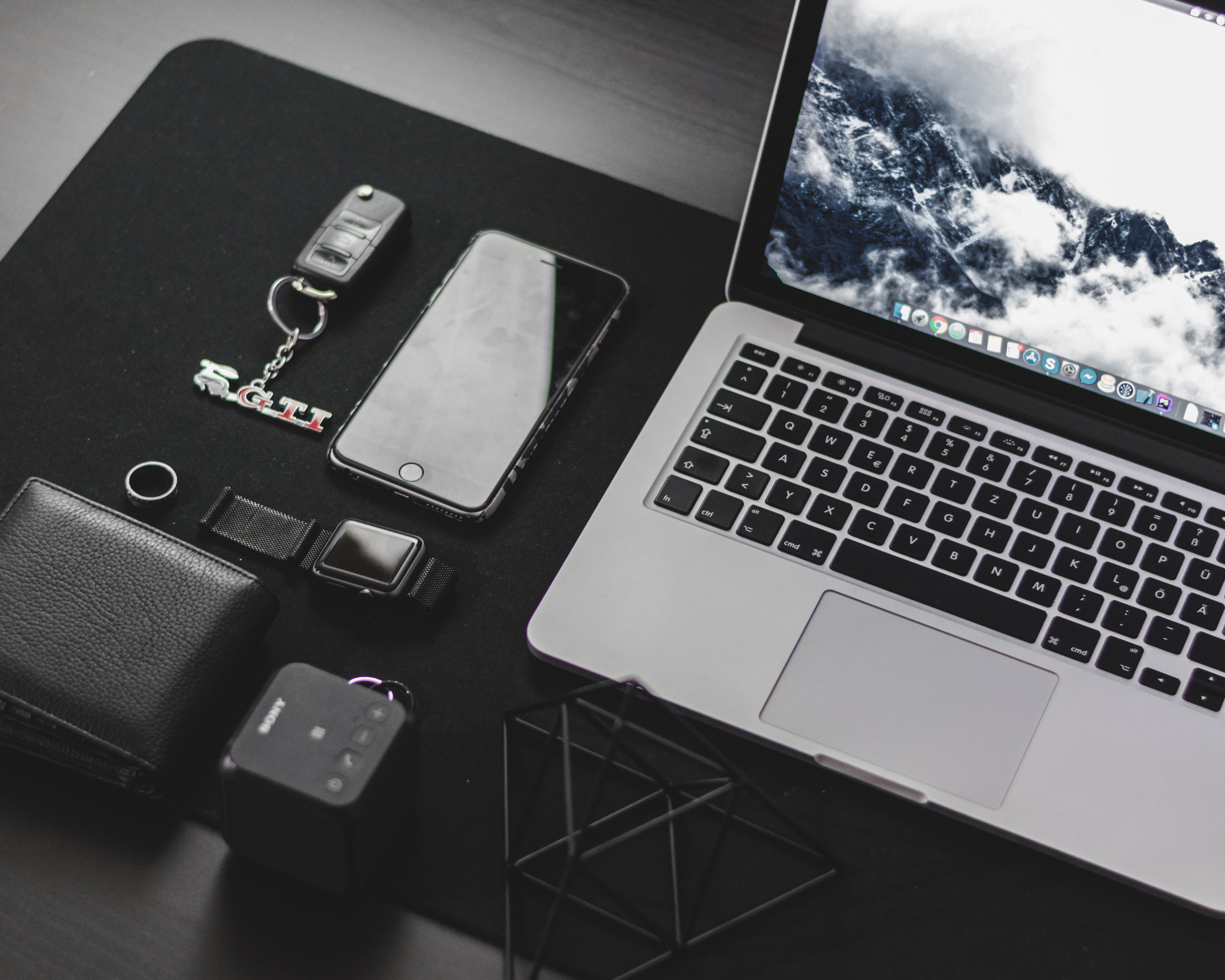 MacBook Pro on top of desk