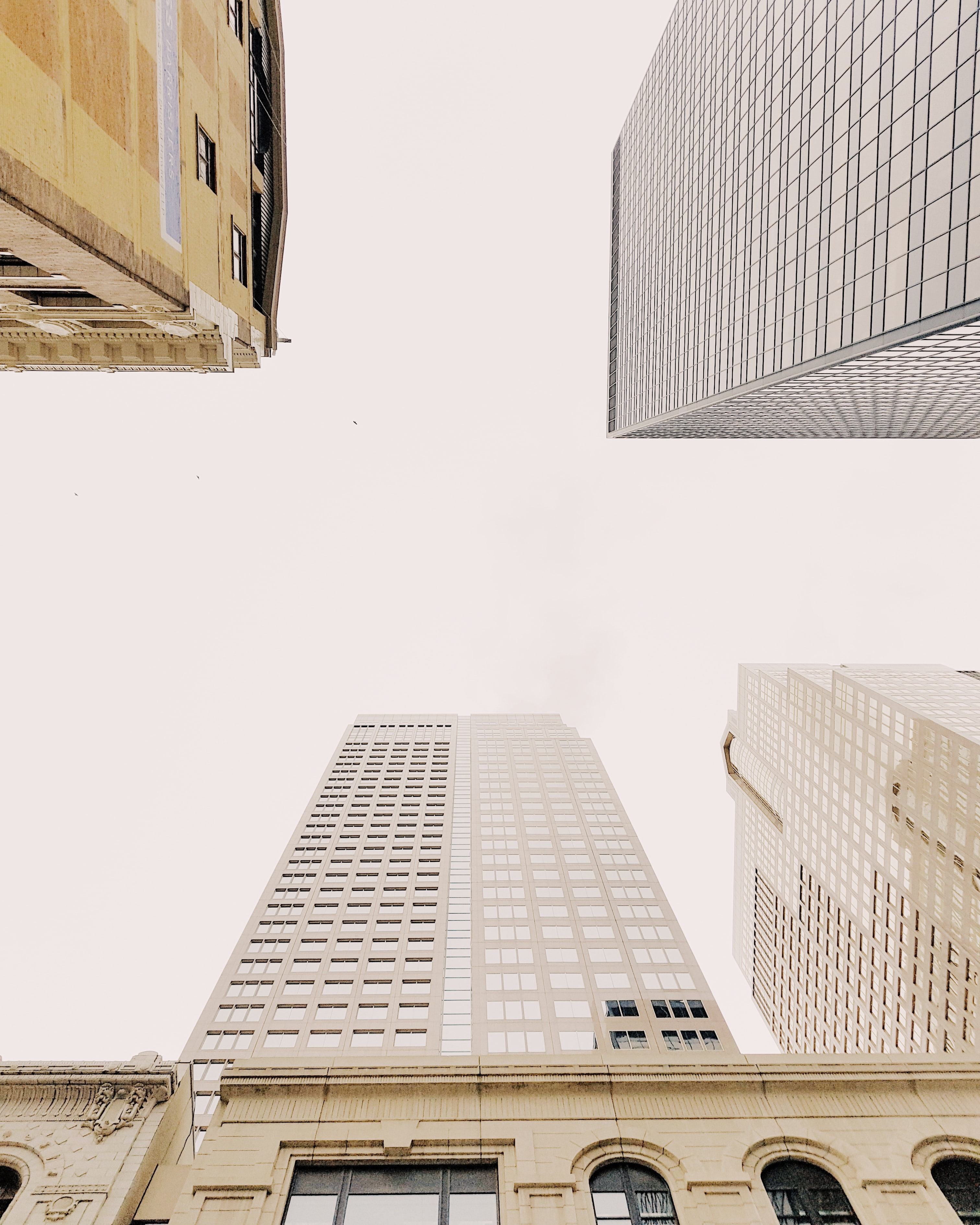 high-angle photography of gray high-rise building at daytime