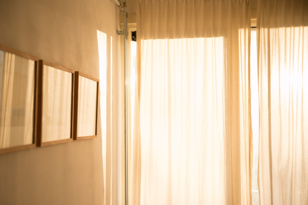 room with white window curtains