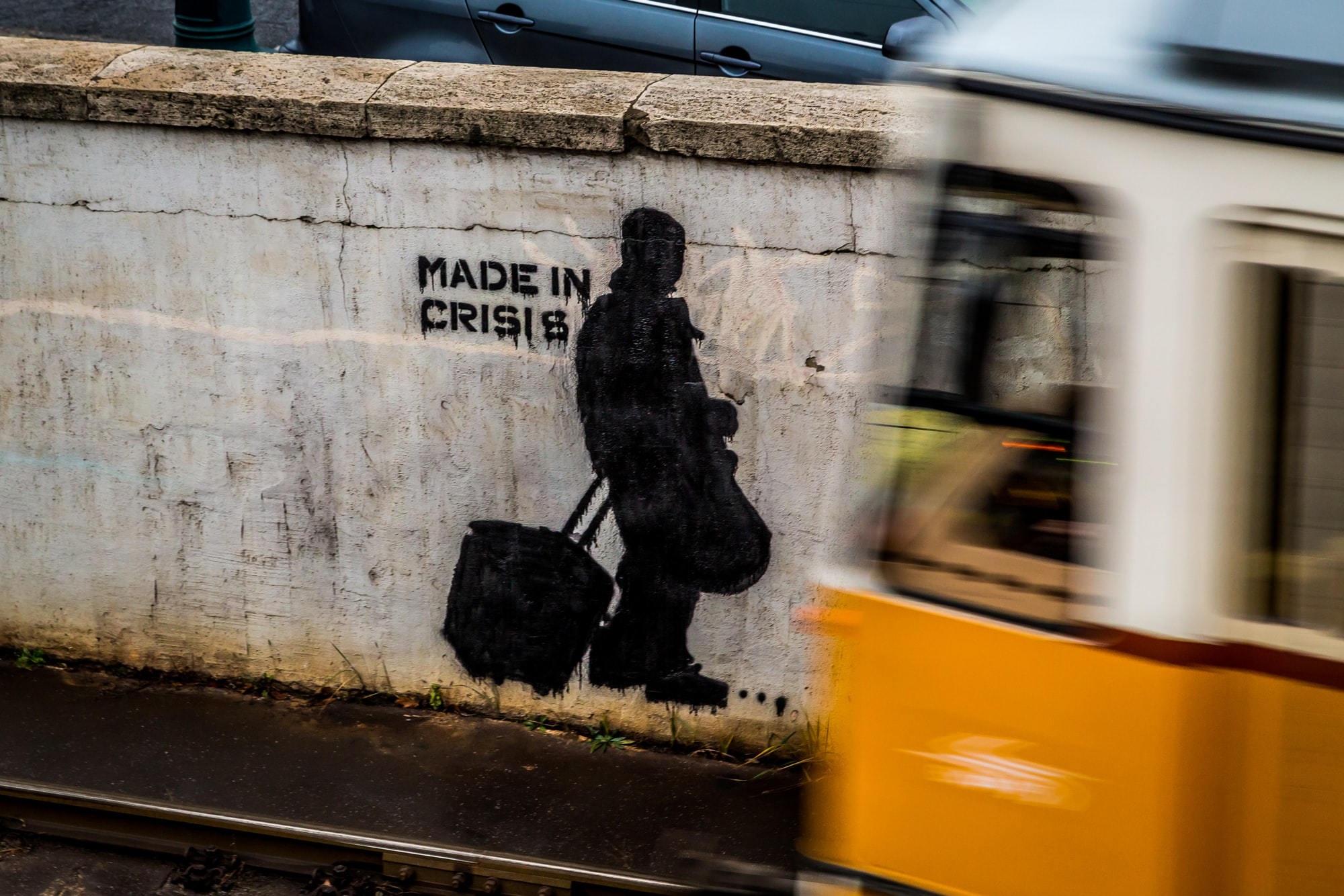 During a city trip to Budapest, Hungary, I saw this stencil street art on a wall at a metro line. For the photo, I chose a shutter speed slower than the metro expected would be and waited some minutes until the metro came.
