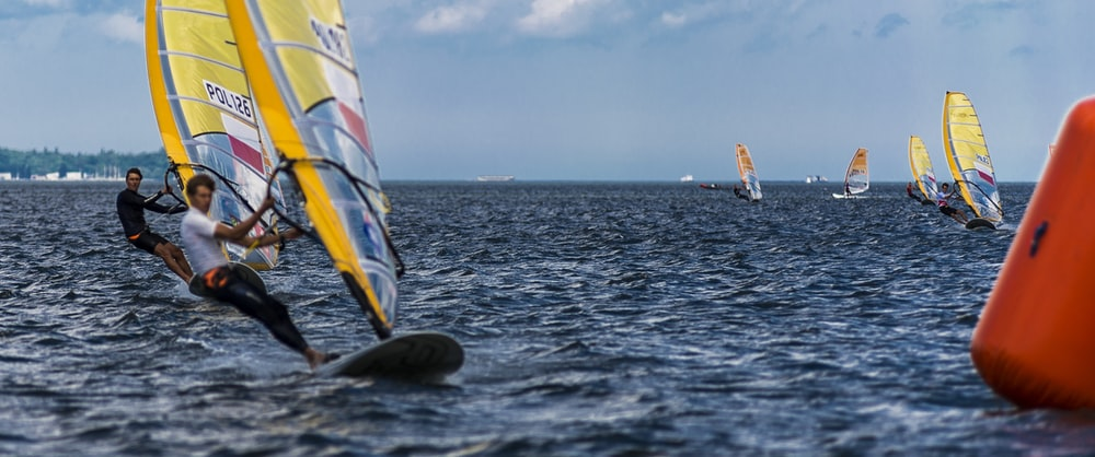 people windsurfing on body of water
