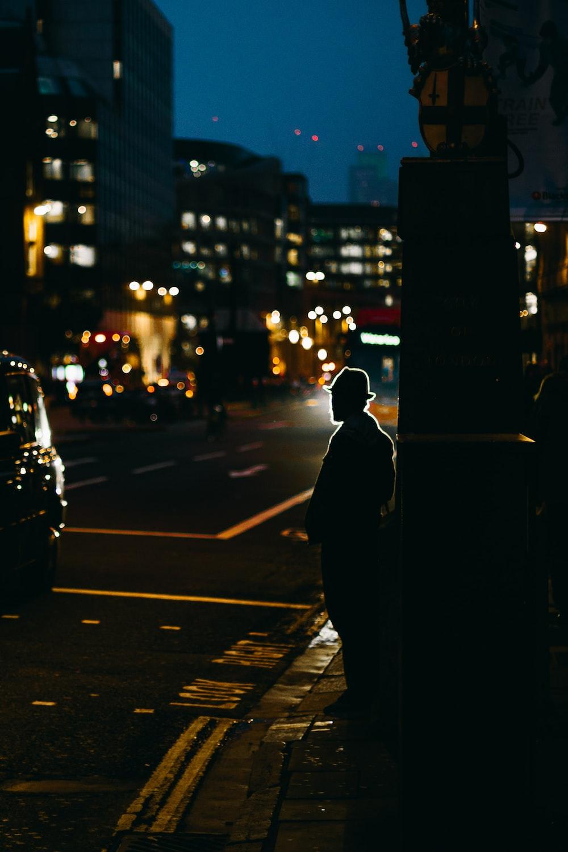 man standing on sidewalk