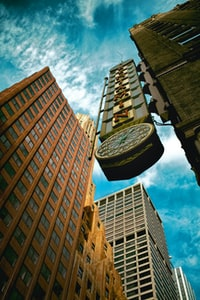 worm's eye view of city clock