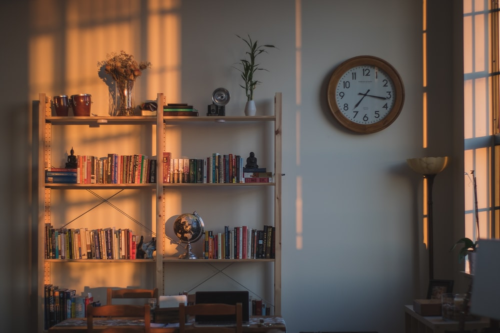 brown wooden double bookcase