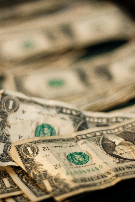 shallow focus photography of U.S. dollar banknotes