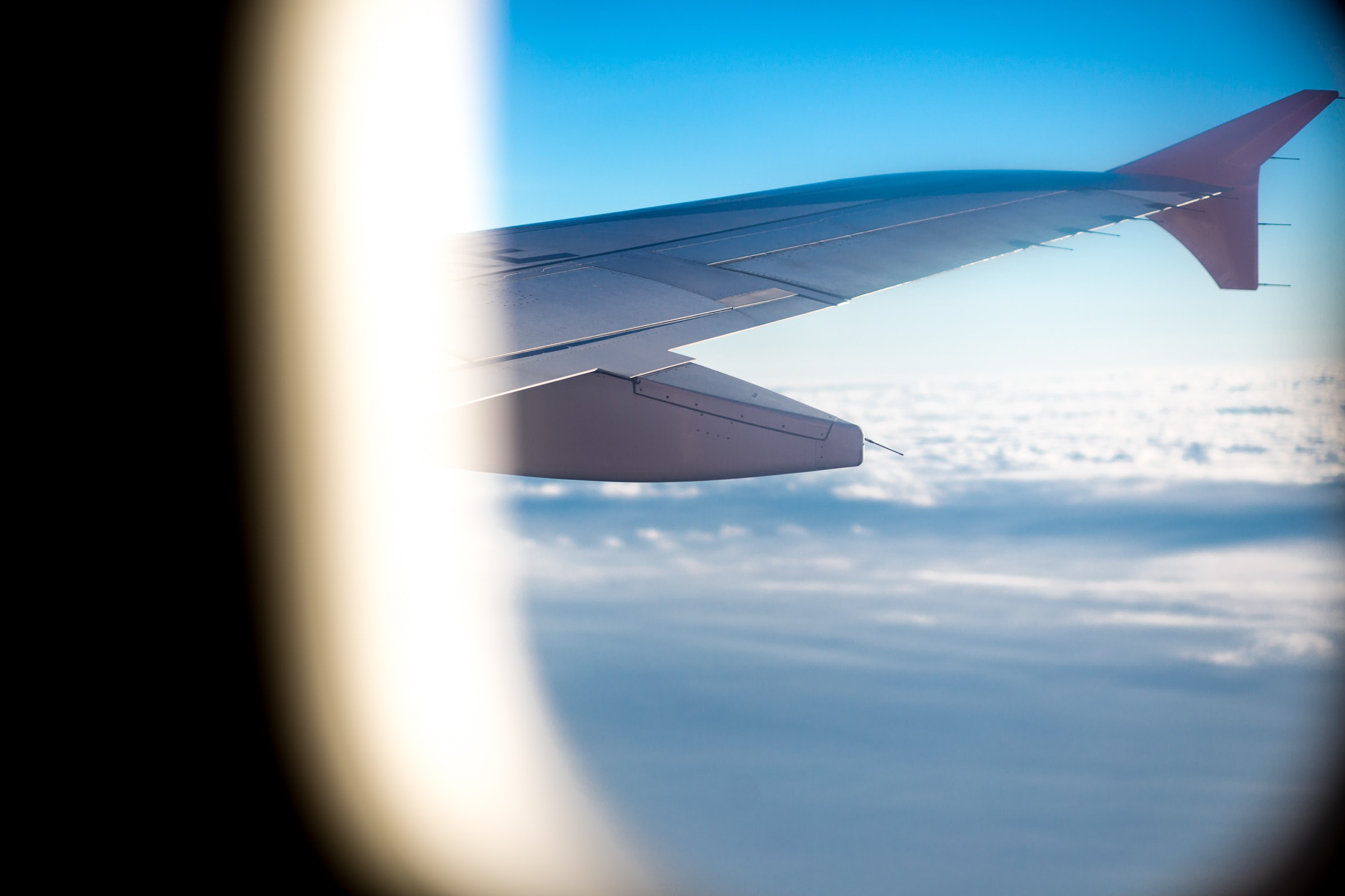 window view of right wing of airplane