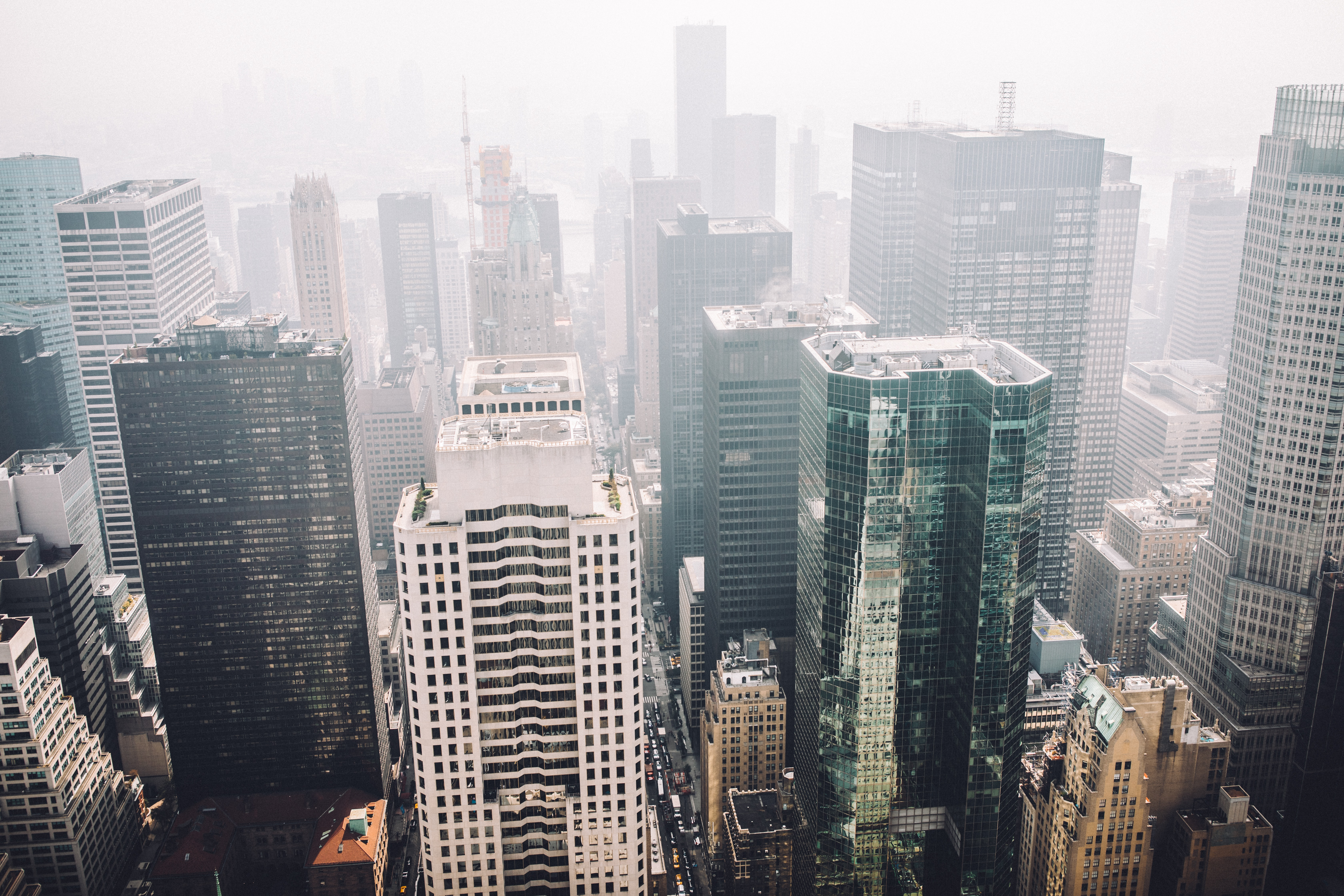 aerial photography of foggy cityscape